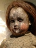 Burned, soot covered doll before and after repair